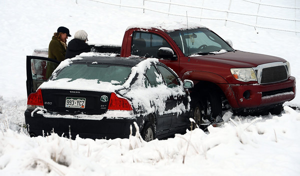 """Drivers of two of the cars involved in the diagonal accident inspect the damage to their cars.<br /> Icy roads caused a 5-car accident on the diagonal north of Boulder and south of Jay Road Thursday morning. There were no injuries reported.<br /> For a video and more photos, go to  <a href=""""http://www.dailycamera.com"""">http://www.dailycamera.com</a>.<br /> Cliff Grassmick  / October 25, 2012"""