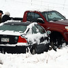 "Drivers of two of the cars involved in the diagonal accident inspect the damage to their cars.<br /> Icy roads caused a 5-car accident on the diagonal north of Boulder and south of Jay Road Thursday morning. There were no injuries reported.<br /> For a video and more photos, go to  <a href=""http://www.dailycamera.com"">http://www.dailycamera.com</a>.<br /> Cliff Grassmick  / October 25, 2012"