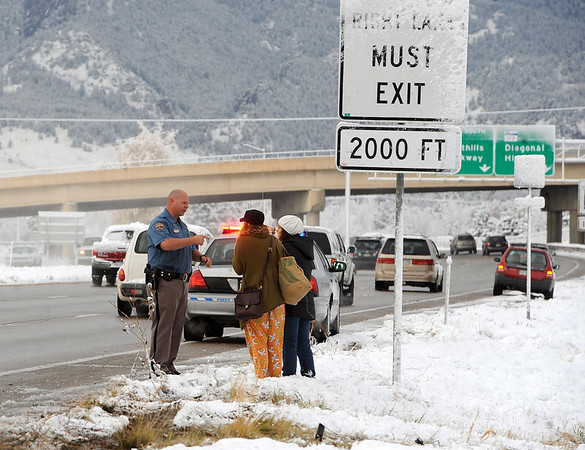 """Drivers involved in the accident talk to a Colorado State Patrol Officer.<br /> Icy roads caused a 5-car accident on the diagonal north of Boulder and south of Jay Road Thursday morning. There were no injuries reported.<br /> For a video and more photos, go to  <a href=""""http://www.dailycamera.com"""">http://www.dailycamera.com</a>.<br /> Cliff Grassmick  / October 25, 2012"""