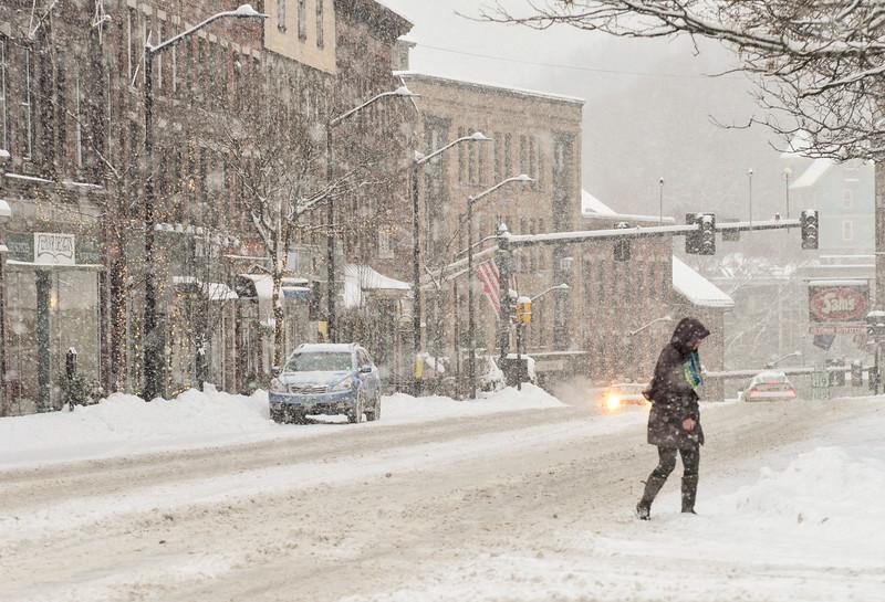 KRISTOPHER RADDER - BRATTLEBORO REFORMER<br /> People cross Main Street in Brattleboro during Monday's snow storm.