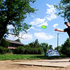 """Sam Reed, of Boulder tees off Saturday morning at the 5th annual Disc Golf Tournament. The tournament was held at Harlow Platts Park. Rachel Woolf/ For the Daily Camera<br /> For more photos and a video of the tournament, go to  <a href=""""http://www.dailycamera.com"""">http://www.dailycamera.com</a>"""