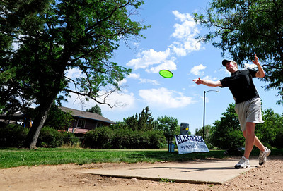 Sam Reed, of Boulder tees off Saturday morning at the 5th annual Disc Golf Tournament. The tournament was held at Harlow Platts Park. Rachel Woolf/ For the Daily Camera For more photos and a video of the tournament, go to www.dailycamera.com