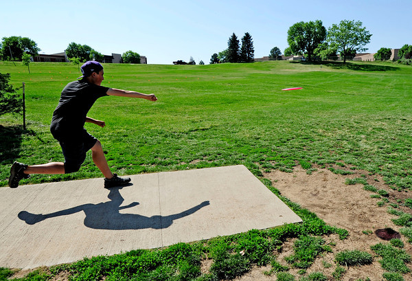 "Eagle McMahon, 14 of Boulder, tees off Saturday morning at the 5th annual Disc Golf Tournament. The tournament was held at Harlow Platts Park. Rachel Woolf/ For the Daily Camera<br /> For more photos and a video of the tournament, go to  <a href=""http://www.dailycamera.com"">http://www.dailycamera.com</a>"