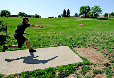 Eagle McMahon, 14 of Boulder, tees off Saturday morning at the 5th annual Disc Golf Tournament. The tournament was held at Harlow Platts Park. Rachel Woolf/ For the Daily Camera For more photos and a video of the tournament, go to www.dailycamera.com