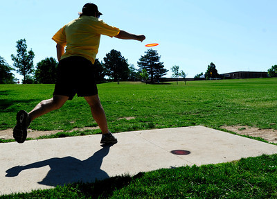 Mike Oswald, of Boulder tees off Saturday morning at the 5th annual Disc Golf Tournament. The tournament was held at Harlow Platts Park. Rachel Woolf/ For the Daily Camera For more photos and a video of the tournament, go to www.dailycamera.com