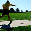 """Mike Oswald, of Boulder tees off Saturday morning at the 5th annual Disc Golf Tournament. The tournament was held at Harlow Platts Park. Rachel Woolf/ For the Daily Camera<br /> For more photos and a video of the tournament, go to  <a href=""""http://www.dailycamera.com"""">http://www.dailycamera.com</a>"""