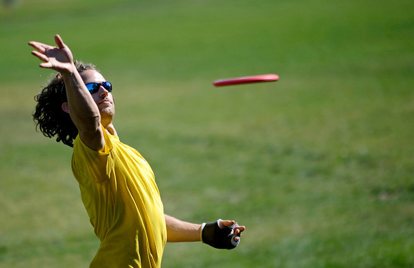 """Chris Montague, of Boulder, throws a disc Saturday morning at the 5th annual Disc Golf Tournament. The tournament was held at Harlow Platts Park. Rachel Woolf/ For the Daily Camera<br /> For more photos and a video of the tournament, go to  <a href=""""http://www.dailycamera.com"""">http://www.dailycamera.com</a>"""
