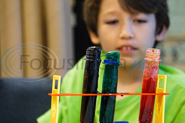 Kane Yacyszyn, 9, watches his test tube bubble over at Discovery Science Place's Chemical Engineering camp.