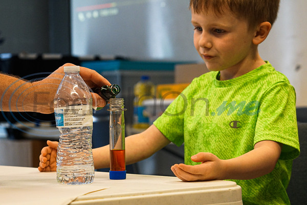 Brenden Ethridge, 6, watches as food coloring is poured into his test tube to create his lava lamp at Discovery Science Place's Chemical Engineering camp.