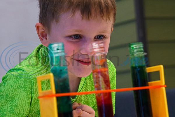 Brenden Ethridge, 6, watches in giddy excitement as his test tube begins to bubble in his lava lamp at Discovery Science Place's Chemical Engineering camp.