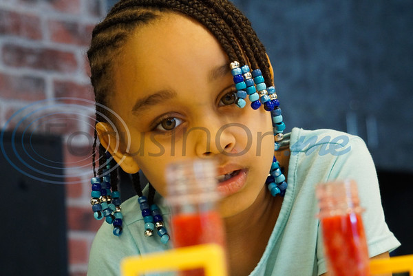 Andrea Johnson, 8, turns her attention to her lava lamp at Discovery Science Place's Chemical Engineering camp.