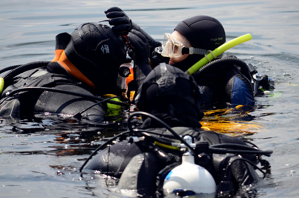 . Members of the Berkshire County Sheriff department dive team prepare to search for a discarded handgun in Onota Lake, Wednesday Aug 20, 2014.  Pictured are Superintendant Jack Quinn (left), Laurie Rock (right) and Lt. Col. Tom Grady (front).  The handgun in question was thrown in the lake after a man decided not to use it to take his own life three years ago. Ben Garver / Berkshire Eagle Staff / photos.berkshireeagle.com