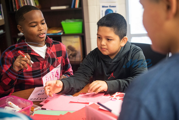 Dixie Elementary School students Kayden Carey, 9, and Jaffet Cuarenta, 19, make Valentine's Day cards for veterans at their school on Feb. 7, 2020. The project was set up through a partnership with Hospice of East Texas.  (Sarah A. Miller/Tyler Morning Telegraph)