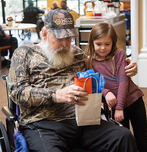 Parker Johnson, 5, of Troup, hands out a Valentine's Day bag with a card from Dixie Elementary students to Air Force veteran Bob Delk at Park Place Nursing and Rehabilitation Center in Tyler on Monday, Feb. 10, 2020. Johnson's mother is Suzanne Johnson of Hospice of East Texas which partnered with Dixie Elementary School to make Valentine's Day cards for local veterans.   (Sarah A. Miller/Tyler Morning Telegraph)