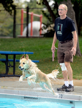 "Herman Sievering, of Boulder, and his dog Kallie play fetch during Dog Dayz at Scott Carpenter Pool on Monday, Sept. 17, in Boulder. For more photos and video of Dog Dayz go to  <a href=""http://www.dailycamera.com"">http://www.dailycamera.com</a><br /> Jeremy Papasso/ Camera"