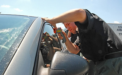 08-10-11  --dogs locked in 04--  At 12:27 p.m. Cobb County Animal Control Officer Nick Walker uses a laser temperature gun to measure the temperature inside the locked car which reads a range between 102-120 degrees. STAFF/LAURA MOON.