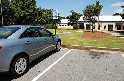 08-10-11  --dogs locked in 11--  The Lovin s left their two dogs inside an unattended, locked car with the windows rolled completely up and no water in direct sunlight outside of the Cobb County Animal Control at noon on Wednesday afternoon. STAFF/LAURA MOON.