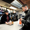 "McDonalds employee Monica Salcido, left, smiles as she serves Levi Davis, of Arvada, on Friday, Feb. 3, at the McDonalds on 28th Street in Boulder. For a video about why a new McDonalds is being built go to  <a href=""http://www.dailycamera.com"">http://www.dailycamera.com</a><br /> Jeremy Papasso/ Camera"