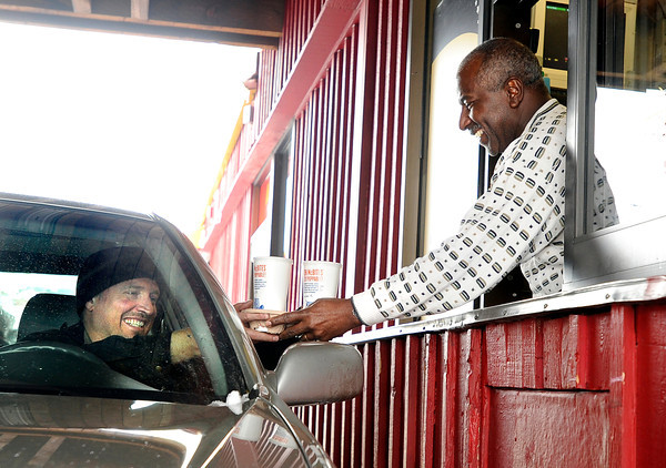 "McDonalds store owner Aaron Holland, right, helps out during a busy lunch by handing Cody Weller, of Boulder, his beverages at the double drive-thru on Friday, Feb. 3, at the McDonalds on 28th Street in Boulder. For a video about why a new McDonalds is being built go to  <a href=""http://www.dailycamera.com"">http://www.dailycamera.com</a><br /> Jeremy Papasso/ Camera"