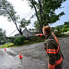 KRISTOPHER RADDER — BRATTLEBORO REFORMER<br /> Brattleboro Firefighter Ben Aither talks about a downed tree on the corner of Bonnyvale Road and Mather Road after a rainstorm that passed through the area on Wednesday, Aug. 7, 2019.