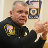 Dracut police chief Peter Bartlett, wearing the current patch. He's had a new one designed that includes the town seal and year of incorporation. It will debut when they switch to short-sleeve uniform shirts in April. (SUN/Julia Malakie)