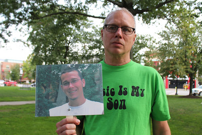 LAWRENCE PANTAGES / GAZETTE Chip Jenkins of Seville attended Monday's event on the Square where he and others spoke about drug rehabilitation in Medina County. Jenkins is shown with a photo of his son Alex, 26, who died of an overdose in January.