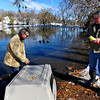 DUCKS<br />  Peter Lawton, left, and Paul Szilagyi, residents of the neighborhood near Maxwell Park off Linden Drive in Boulder, set up a cage to catch a gaggle of ducks on Thursday. The young ducks have no mother, and do not know how to migrate to warmer climes for the winter. Lawton intends to take them to the Greenwood Wildlife Rehabilitation Center in Lyons for the winter.<br /> <br /> Photo by Marty Caivano/Nov. 3, 2011