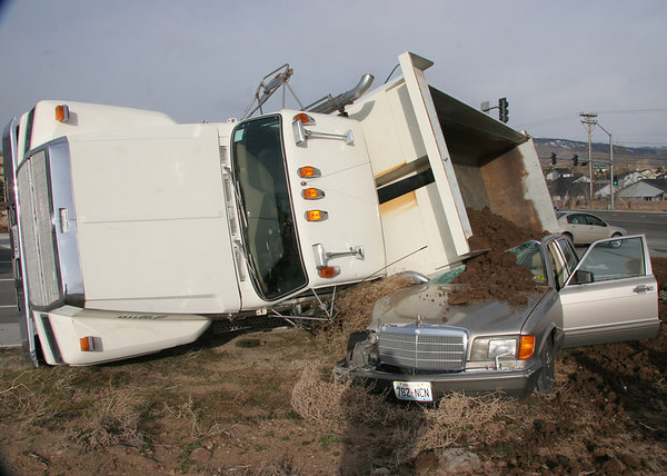 Dump truck loses it