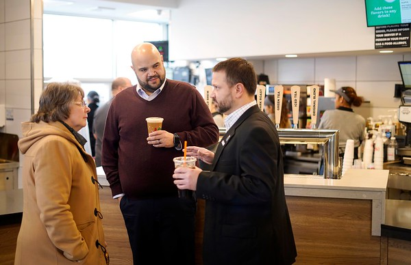 BEN GARVER — THE BERKSHIRE EAGLE<br /> Lisa Fletcher-Udel, Earl Persip and Pete White enjoy coffee at the new Dunkin' on First Street in Pittsfield, Wednesday, January 10, 2019.  The new restaurant  offers the region's first look at the brand's new stores, with a modern atmosphere and new and innovative technologies and design elements -- including the first drive-thru exclusively for mobile ordering -- to make running on Dunkin' faster than ever before.