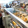 BEN GARVER — THE BERKSHIRE EAGLE<br /> The new Dunkin' on First Street in Pittsfield opened Wednesday, January 10, 2019.  One of the major design changes includes glass displays for the doughnuts. The new restaurant offers the region's first look at the brand's new stores, with a modern atmosphere and new and innovative technologies and design elements -- including the first drive-thru exclusively for mobile ordering -- to make running on Dunkin' faster than ever before.