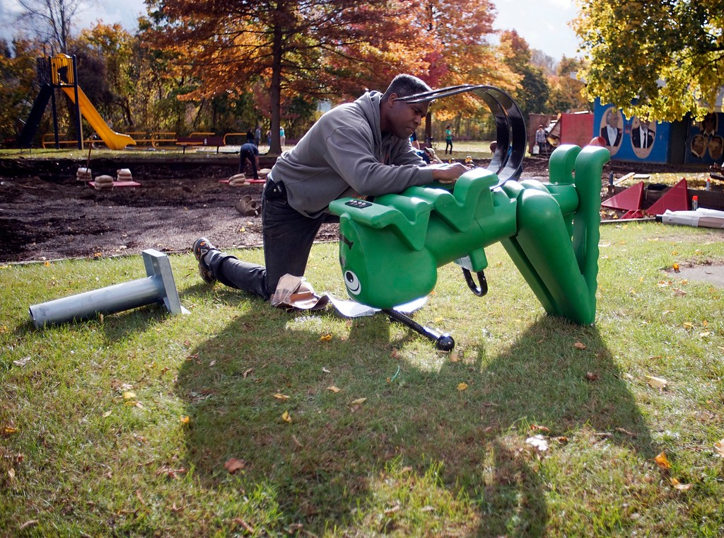 . WIlliam Peets, a volunteer from General Dynamics, assembles a playground toy at Durant Park in Pittsfield, Friday October 21, 2016. Ben Garver � The Berkshire Eagle
