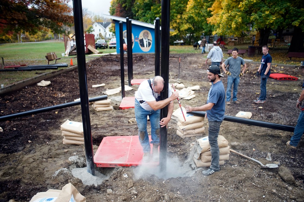 . Bob Petinelli, a contractor from Burlington Vermont who specializes in playgrounds, sets one of the posts for the new playground at Durant Park in Pittsfield, Friday, October 21, 2016. Ben Garver � The Berkshire Eagle
