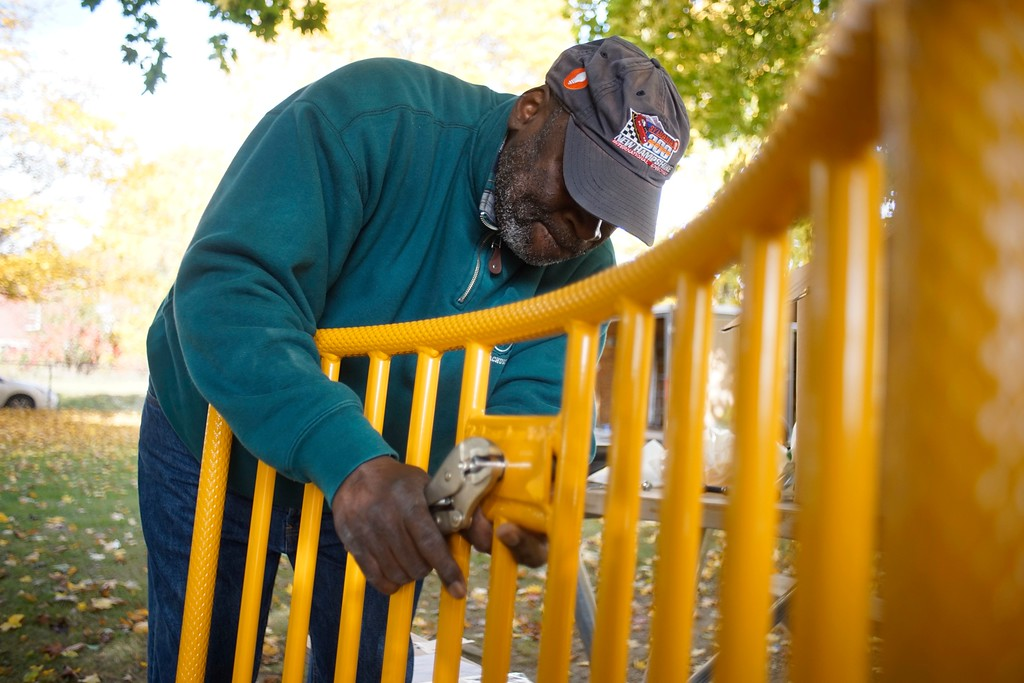 . Warren Alexander assembles playground equipment at Durant Park in Pittsfield. Alexander is a volunteer working on a two day project to rebuild the playground at the park, Friday, October 21, 2016. Ben Garver � The Berkshire Eagle