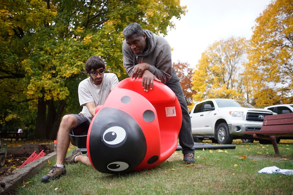 . Taylor Maak and William Peets build a ladybug playground toy at Durant Park in Pittsfield. The pair are part of a two day effort to rebuild the park\'s playground, Friday, October 21, 2016. Ben Garver � The Berkshire Eagle
