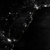 "NASA NIGHT PHOTOS<br /> This image of part of the Atlantic coast of South America was acquired by the Suomi NPP satellite on the night of July 20, 2012. The image was made possible by the ""day-night band"" of the Visible Infrared Imaging Radiometer Suite (VIIRS), which detects light in a range of wavelengths from green to near-infrared and uses filtering techniques to observe dim signals such as city lights, gas flares, auroras, wildfires, and reflected moonlight."