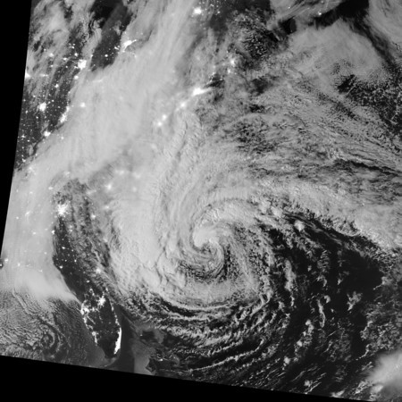"""NASA NIGHT PHOTOS<br /> This image of Hurricane Sandy was acquired by the Visible Infrared Imaging Radiometer Suite (VIIRS) on the Suomi NPP satellite at 2:42 a.m. Eastern Daylight Time (06:42 Universal Time) on October 28, 2012. Suomi NPP was launched one year ago today on a mission to extend and enhance long-term records of key environmental data.<br /> The storm was captured by a special """"day-night band,"""" which detects light in a range of wavelengths from green to near-infrared and uses filtering techniques to observe dim signals such as auroras, airglow, gas flares, city lights, fires, and reflected moonlight. In this case, cloud tops were lit by the nearly full Moon (full occurs on October 29). Some city lights in Florida and Georgia are also visible through the clouds."""