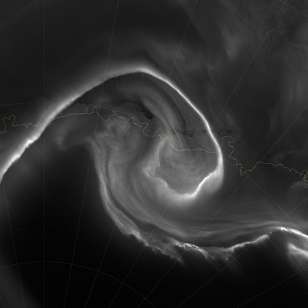 "NASA NIGHT PHOTOS<br /> On July 15, 2012, the Visible Infrared Imaging Radiometer Suite (VIIRS) on the Suomi NPP satellite captured this nighttime view of the aurora australis, or ""southern lights,"" over Antartica's Queen Maud Land and the Princess Ragnhild Coast.<br /> The image was captured by the VIIRS ""day-night band,"" which detects light in a range of wavelengths from green to near-infrared and uses filtering techniques to observe signals such as city lights, auroras, wildfires, and reflected moonlight. In the case of the image above, the sensor detected the visible auroral light emissions as energetic particles rained down from Earth's magnetosphere and into the gases of the upper atmosphere. The slightly jagged appearance of the auroral lines is a function of the rapid dance of the energetic particles at the same time that the satellite is moving and the VIIRS sensor is scanning."