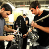 From left to right Benjamin Fuoss and Austin Schipper prepare to set in the Inertia Engine Dyno as they work on their vehicle in their lab in the Engineering Building on the CU Boulder campus as part of the University of Colorado at Boulder Shell Eco-Marathon Team.<br /> Photo by Paul Aiken / The Boulder Daily Camera / January 18, 2013