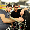 From left to right Benjamin Fuoss and Austin Schipper prepares to set in the tiny gas tank as the team works on their vehicle in their lab in the Engineering Building on the CU Boulder campus as part of the University of Colorado at Boulder Shell Eco-Marathon Team.<br /> Photo by Paul Aiken / The Boulder Daily Camera / January 18, 2013