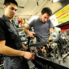 From left to right Kyle Jacques and Benjamin Fuoss set in the rear sub frame including gearing, transmission and rear wheel as they work on their vehicle in their lab in the Engineering Building on the CU Boulder campus as part of the University of Colorado at Boulder Shell Eco-Marathon Team.<br /> Photo by Paul Aiken / The Boulder Daily Camera / January 18, 2013