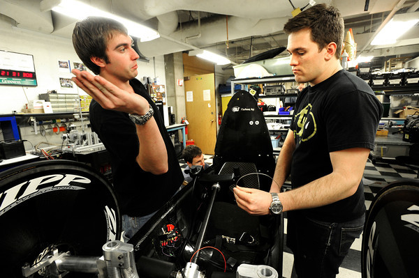 From left to right Austin Schipper and Kelsey Spurr discuss their plans in changing the braking system and clutch as they work on their vehicle in their lab in the Engineering Building on the CU Boulder campus as part of the University of Colorado at Boulder Shell Eco-Marathon Team.<br /> Photo by Paul Aiken / The Boulder Daily Camera / January 18, 2013
