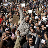 People demonstrate in Cairo, Egypt, Monday, Jan. 31, 2011. A coalition of opposition groups called for a million people to take to Cairo's streets Tuesday to ratchet up pressure for President Hosni Mubarak to leave. (AP Photo/Ben Curtis)