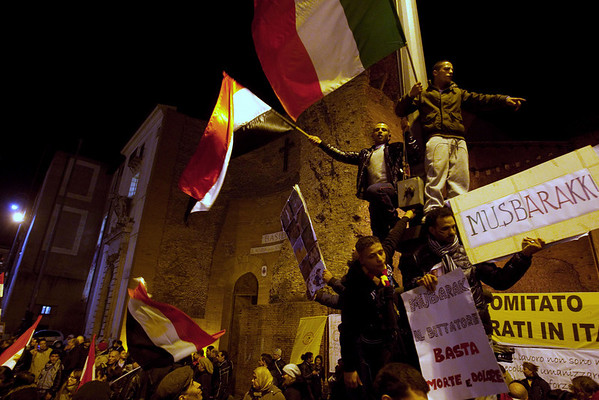 "Demonstrators wave Egyptian and Italian flags during a protest in support of the Egyptian people, in central Rome, Italy, Monday, Jan. 31, 2011. Demonstrators gathered to rally against Egypt's President Hosni Mubarak, in a show of support for for protests currently taking place in Egypt. Sign in the foreground at right reads in Italian ""Mubarak the dictator enough death and pain"". (AP Photo/Andrew Medichini)"
