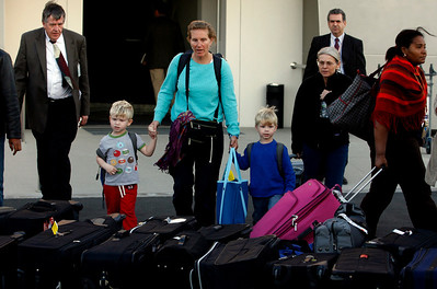 People evacuated from Egypt pick up their luggage from outside Larnaca airport terminal, Cyprus, Monday, Jan. 31, 2011. They were among 42 people evacuated from Cairo aboard a U.S. military plane. Most of the 42 were U.S. citizens working at embassies including South Africa, Uganda, Ghana, Ukraine and Russia, but several were third country nationals - also employees at U.S. embassies - who were in Cairo for a conference. (AP Photo/Philippos Christou)
