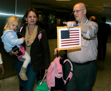 An American family, part of around 150 U.S. nationals, arrives at Ataturk Airport in Istanbul, Turkey, from Cairo, Egypt, early Tuesday, Feb.1, 2011. They arrived on a Turkish Airlines  special flight with Turkish nationals as thousands of foreigners were being evacuated from the unrest in Egypt, with countries around the world scrambling to send planes to fly their citizens out. Cairo's short-staffed international airport was a scene of chaos and confusion Monday as thousands of foreigners sought to flee the unrest in Egypt. (AP Photo/Ibrahim Usta)