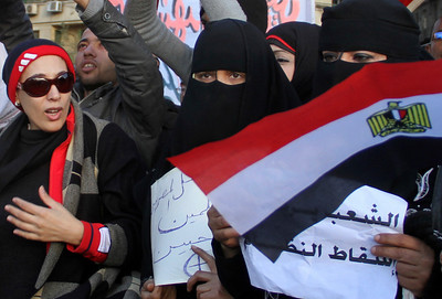 Women demonstrate in Tahrir Square, the central Cairo plaza that has become the protests' epicenter, in Cairo, Egypt, Monday Jan. 31, 2011. A coalition of opposition groups called for a million people to take to Cairo's streets Tuesday to ratchet up pressure for President Hosni Mubarak to leave. (AP Photo/Ahmed Ali)