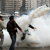 Egyptian protesters throw back a tear gas canister during a protest in Cairo, Egypt, Friday, Jan. 28, 2011. The Egyptian capital Cairo was the scene of violent chaos Friday, when tens of thousands of anti-government protesters stoned and confronted police, who fired back with rubber bullets, tear gas and water cannons. It was a major escalation in what was already the biggest challenge to authoritarian President Hosni Mubarak's 30 year-rule. (AP Photo/Ahmed Ali)