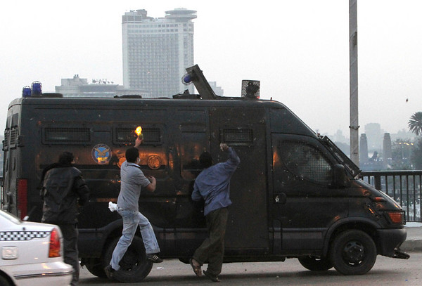 Egyptian protester throw a Molotov cocktail inside anti-riot vehicle during a protest in Cairo, Egypt, Friday, Jan. 28, 2011. The Egyptian capital Cairo was the scene of violent chaos Friday, when tens of thousands of anti-government protesters stoned and confronted police, who fired back with rubber bullets, tear gas and water cannons. It was a major escalation in what was already the biggest challenge to authoritarian President Hosni Mubarak's 30 year-rule. (AP Photo/Ahmed Ali)