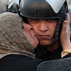 An Egyptian anti-government activist kisses a riot police officer following clashes  in Cairo, Egypt, Friday, Jan. 28, 2011. Tens of thousands of anti-government protesters poured into the streets of Egypt Friday, stoning and confronting police who fired back with rubber bullets and tear gas in the most violent and chaotic scenes yet in the challenge to President Hosni Mubarak's 30-year rule. (AP Photo/Lefteris Pitarakis)