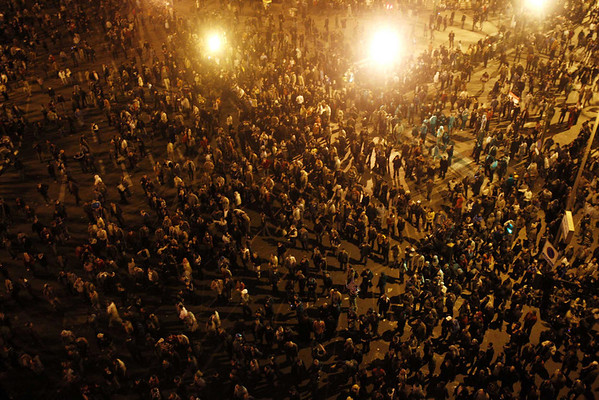 In this photo released by China's Xinhua News Agency, anti-government demonstrators protest in Cairo, capital of Egypt, on Friday, Jan. 28, 2011. Protesters have seized the streets of Cairo, battling police with stones and firebombs, burning down the ruling party headquarters, and defying a night curfew enforced by a military deployment. (AP Photo/Xinhua, Cai Yang) NO SALES